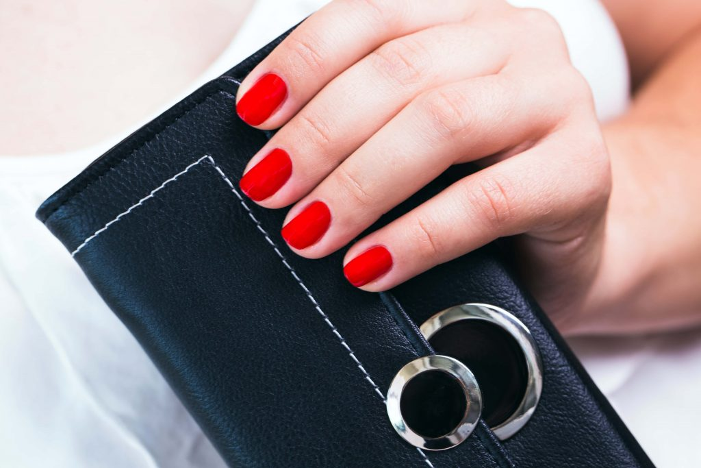 woman holding wallet