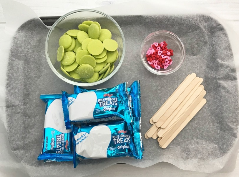 These Grinch Christmas Rice Krispies Treats are a fun and easy treat to make with your kids! This easy recipe is perfect for your next holiday party or making holiday memories watching a favorite Christmas movie with a special treat!