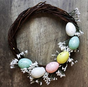 grapevine wreath with pastel speckled Easter eggs