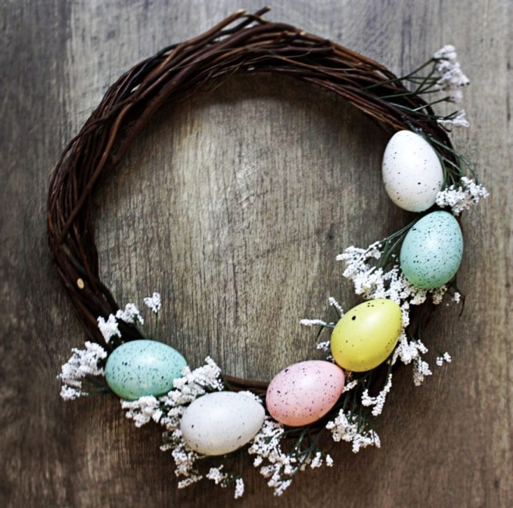 This adorable DIY Easter Wreath is super easy to make with supplies you can grab at the dollar store. Takes just minutes to make, and is the perfect rustic, spring wreath!