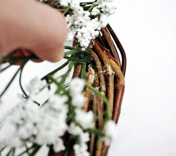 attaching baby's breath to wreath