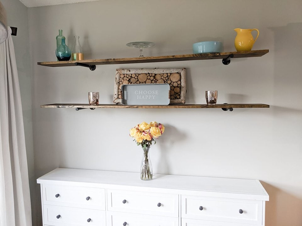 easy DIY pipe shelves above a white credenza