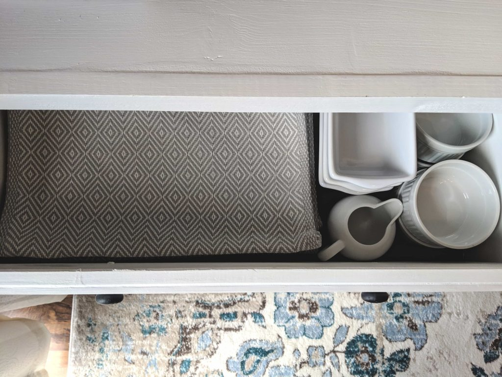 serving ware stored in buffet cabinet
