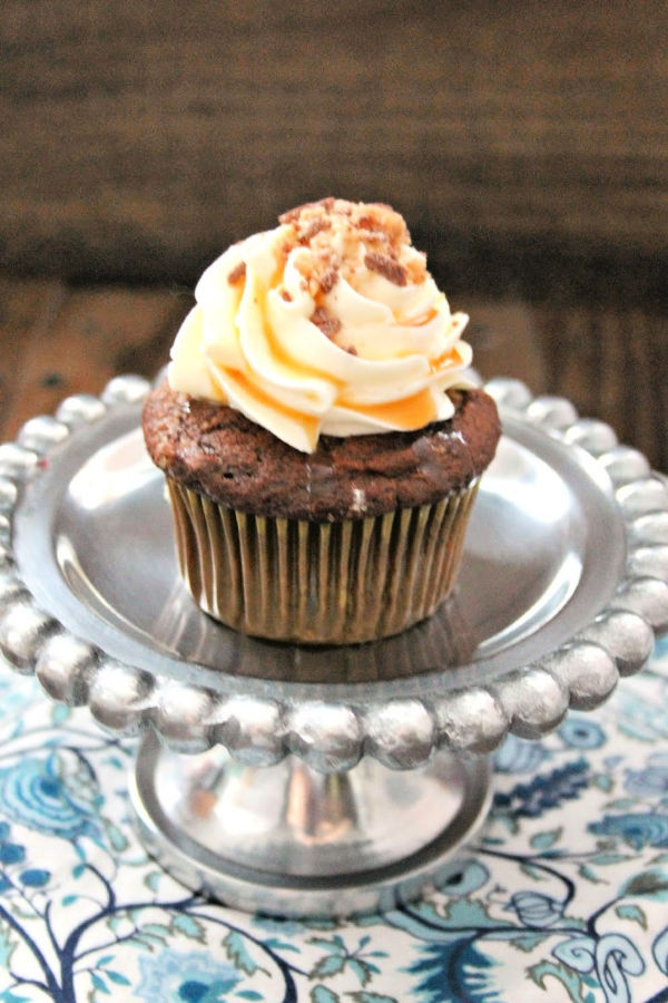 These rich chocolate and toffee Heath Bar Cupcakes can be made with leftover Halloween candy, with a bit of avocado for a healthier twist!
