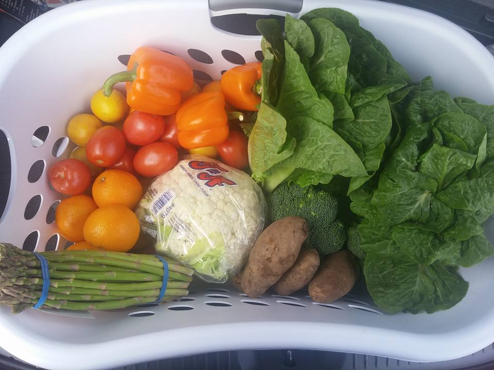 assorted produce in a white basket