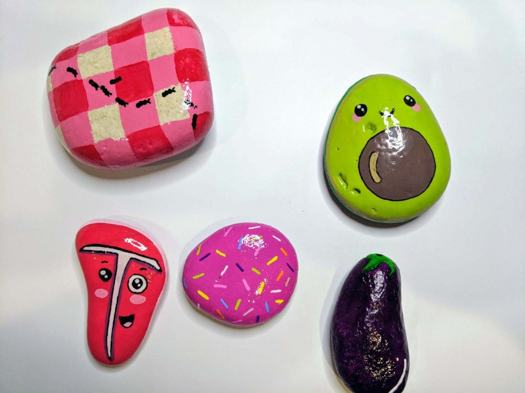 five colorful painted rocks