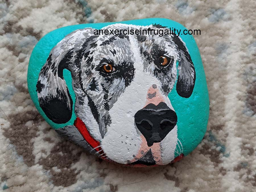 rock painted teal with black and white great dane face